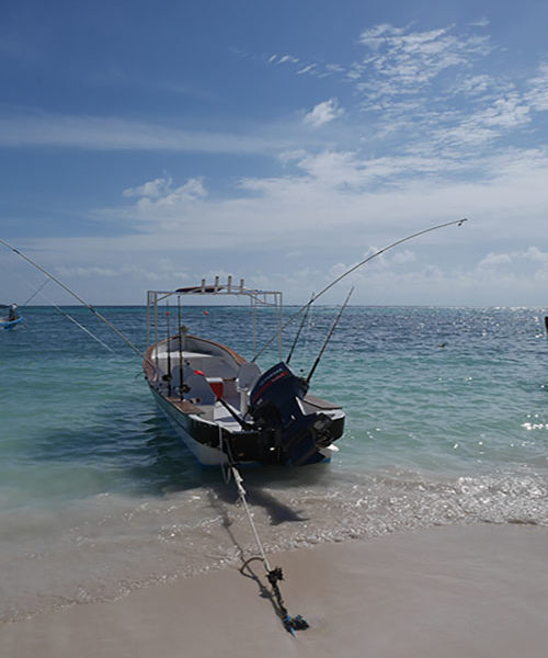 Fisher boat at Akumal Beach in Mexico